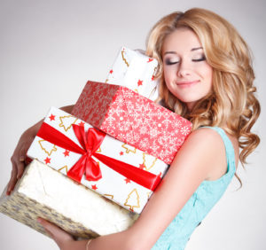 Happy girl with gift box christmas and new year concept